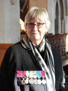 Daughter Edna proudly displays her fathers medals - VC on the left